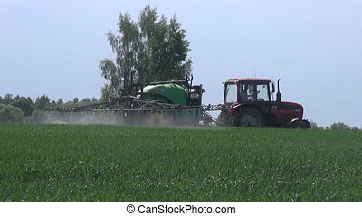 agriculture tractor spraying crop - agriculture tractor...