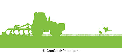 Agriculture tractors plowing the land in cultivated country...