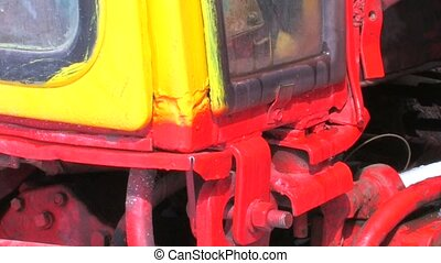 Agrimotor in repair shop, Caterpillar and cab, closeup,...