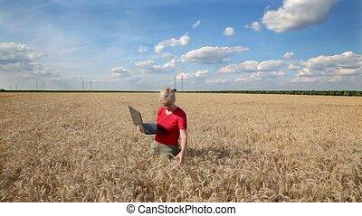 Agronomist examine wheat field