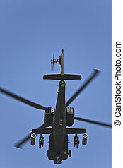 AH-64 Apache attacking military helicopter