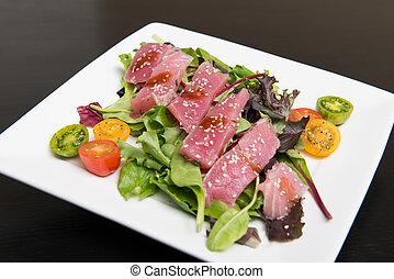 Ahi Tuna Salad - Bright red yellow fin sashimi tuna salad on...