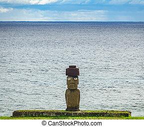 Ahu Ko Te Riku moai with eyes in Rapa Nui against Pacific...