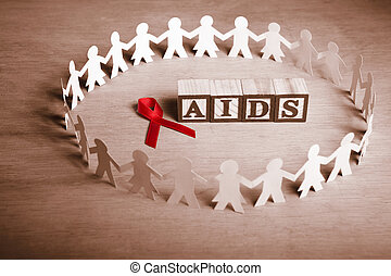AIDS support cause - Red ribbon with word 'AIDS' surrounded...