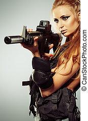 aim a gun - Portrait of a beautiful woman posing in a...