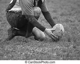 Aim for the post - Black & White image of a rugby player...