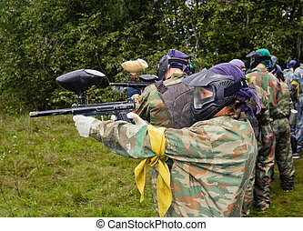 aim paintball players - Paintball players in full gear at...
