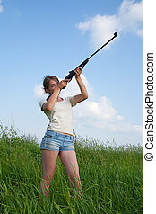 aiming girl - young woman aiming a pneumatic air rifle