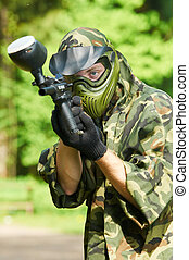 aiming paintball player - paintball sport player in...