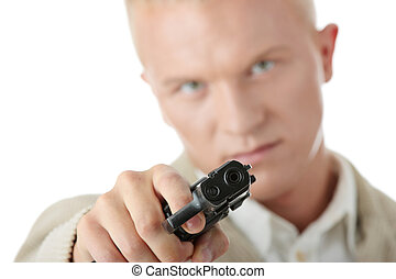 Aiming with pistol in hand - Young caucasian blond man...