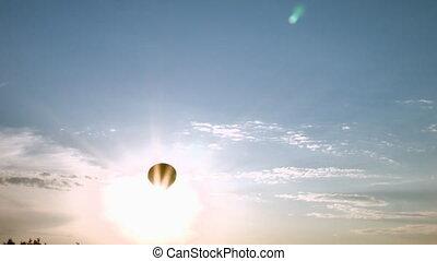 Air balloon cross the sun