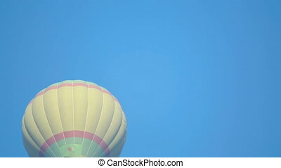 Air balloon - Flying in a balloon in a clear blue sky