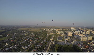 Air balloons flying over town. Summer landscape