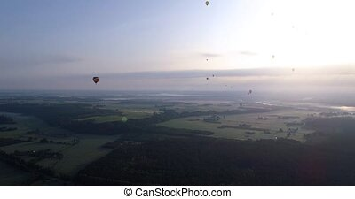 air baloon over green lands at early mornig