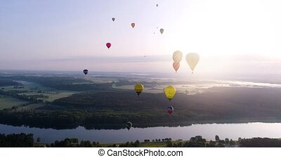 air baloons over green lands and river - air baloons flying...