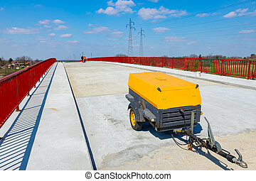 Air compressor parked on the bridge
