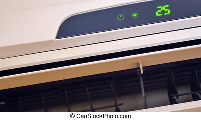 Air conditioner on wall close-up.