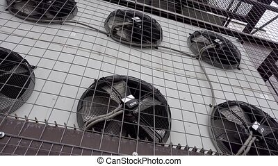 Air conditioner unit fan rotating. Industrial air conditioner unit fan rotating