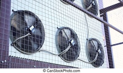 Air conditioner unit fan rotating.Industrial air...