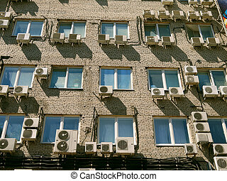 Air conditioners on the fasade ofoffice building. Taken in ...