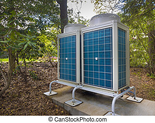 Air conditioning and heating systems on a slab located...