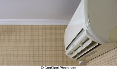 Air conditioning in the house to adjust the temperature in ...