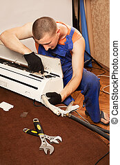 Air conditioning master preparing to install new air conditioner.