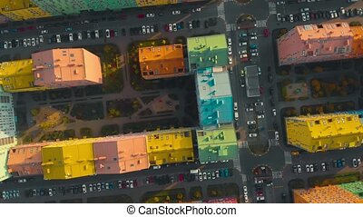 Fall down over residential colored houses. Free fall effect with rotation. Air crash over residential areas in the city. Air crash concept. Fall down at high speed. POV. Top down view, video footage.