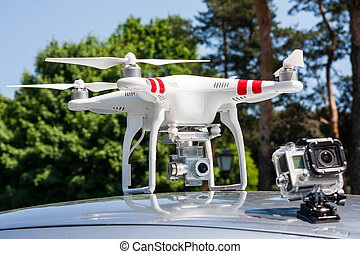 Air drone. - Air drone with action camera on the car roof