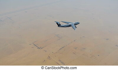 Air force cargo plane over Middle East desert 4K - Air force...