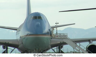 Air Force One with mountains in background