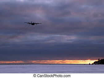 Air force plane at sunset