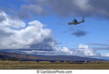 Air Force plane flying low - U.S. Air Force plane C-130...