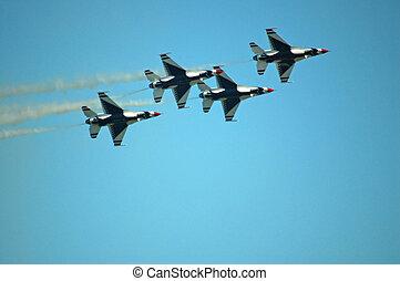 Air Force Thunderbirds - Thunderbird F-16's performing at an...