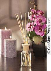 air freshener sticks at home with flowers and ou of focus ...