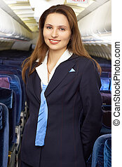 air hostess - air hostress in the empty airliner cabin