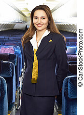 air hostess in the empty jet airliner cabin