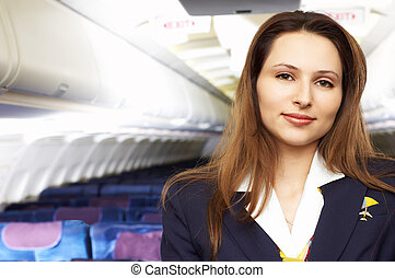 air hostress (stewardess) in the empty airliner cabin
