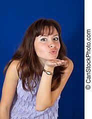 Air-kissing  girl over blue