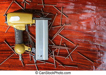 Air Nailer with rusty nail. Equipment for construction and ...