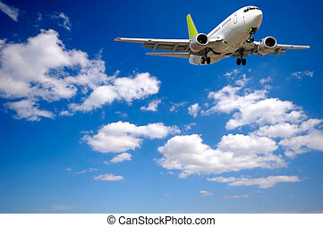 Air plane and clouds - Air plane is flying. With blue and ...