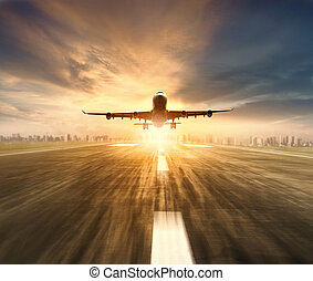 air plane flying over airport runway with city scape and...