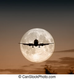 air plane full moon - A photography of a jet air plane in...