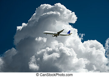 air plane with thunder storm clouds