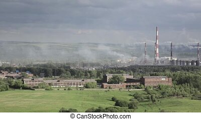 Air pollution above smole city. Pipes throwing smoke towards the city