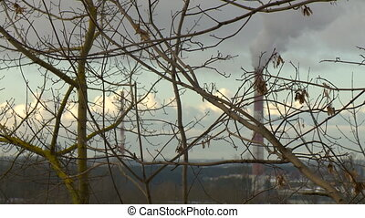 Air pollution by smoke coming out of the factory chimneys in the industrial zone.