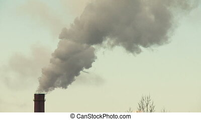 Air pollution by smoke coming out of the factory chimneys.