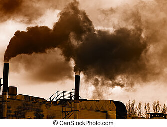 Air pollution - Dark smoke from a smokestack.