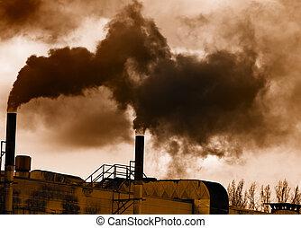 Air pollution - Dark smoke from a smokestack.