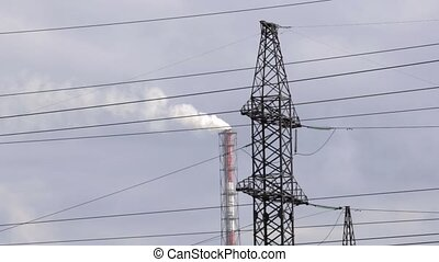 Air pollution from industrial plants. Pipes throwing smoke in the sky